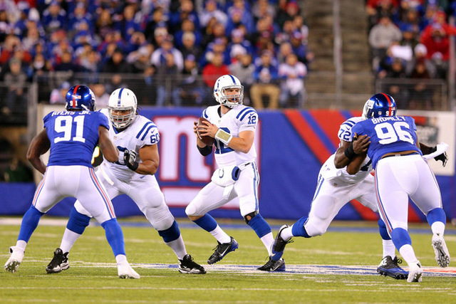 Indianapolis Colts quarterback Andrew Luck (12) drops back to pass against the New York Giants during the first quarter at MetLife Stadium.(Brad Penner-USA TODAY Sports)