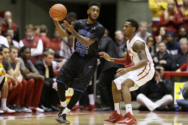 Georgia State guard Ryan Harrow, left, drives around Iowa State guard Monte Morris, right, during the first half of an NCAA college basketball game, Monday, Nov. 17, 2014, in Ames, Iowa. (AP Photo ...