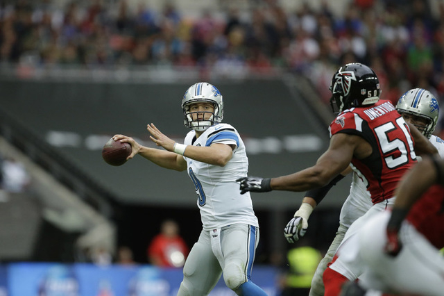 Detroit Lions quarterback Matthew Stafford (9) throws a pass in the second half of the NFL football game against the Atlanta Falcons at Wembley Stadium, London, Sunday, Oct. 26, 2014.  (AP Photo/M ...
