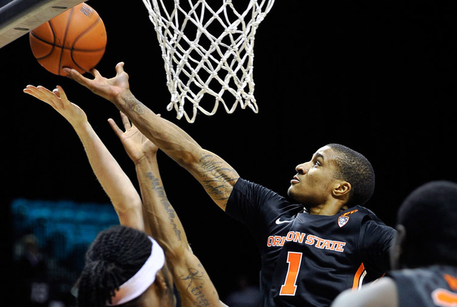 Oregon State's Gary Payton II (1) reaches for a rebound against Oklahoma State during the first half of a NCAA basketball game during the MGM Grand Main Event at the MGM Grand Garden Arena on Mond ...