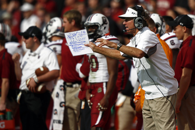 South Carolina head coach Steve Spurrier yells to his team from the sideline in the second quarter of an NCAA college football game against Tennessee on Saturday, Oct. 19, 2013 in Knoxville, Tenn. ...