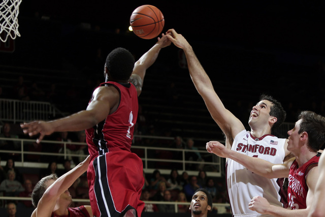 Stanford center Stefan Nastic, right, fights for a rebound against South Dakota guard Trey Norris, left, during the second half of an NCAA college basketball game, Sunday, Nov. 16, 2014, in Stanfo ...