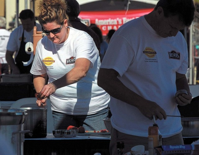 Laurie Lufkin cuts tomatoes during  at the World Food Championship Friday, Nov. 2, 2012 behind Bally's hotel casino. Hundreds of competitors are competing over four days in seven different categor ...