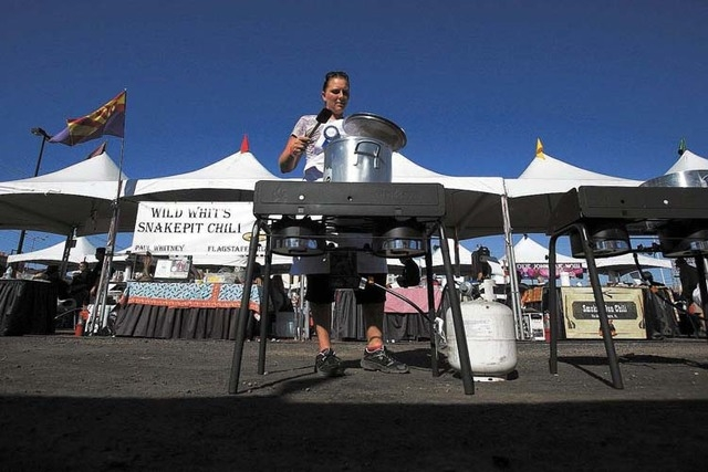Melissa Baldan from San Diego, Cal. makes  chili at the World Food Championship Friday, Nov. 2, 2012 behind Bally's hotel/casino. Hundreds of competitors are competing over four-days in seven diff ...