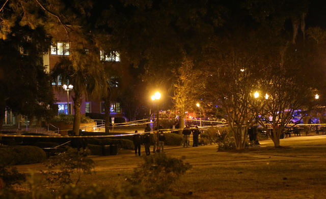 Police investigate a shooting scene at Strozier Library on Florida State campus on Thursday, Nov. 20, 2014, in Tallahassee, Fla. At least two people are being treated for injuries Thursday after a ...