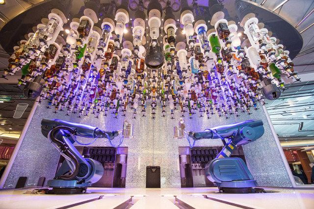 """""""Make mine a double."""" In the Quantum of the Seas Bionic Bar, robotic arms are in charge of mixing the drinks. (Courtesy)"""