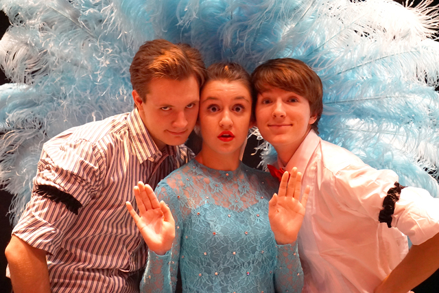 """From left, Harrison Langford as Bob, Jessica Ruettiger as Judy and Jackson Langford as Phil rehearse for Faith Lutheran's production of Irving Berlin's """"White Christmas."""" The Faith Lutheran Theate ..."""