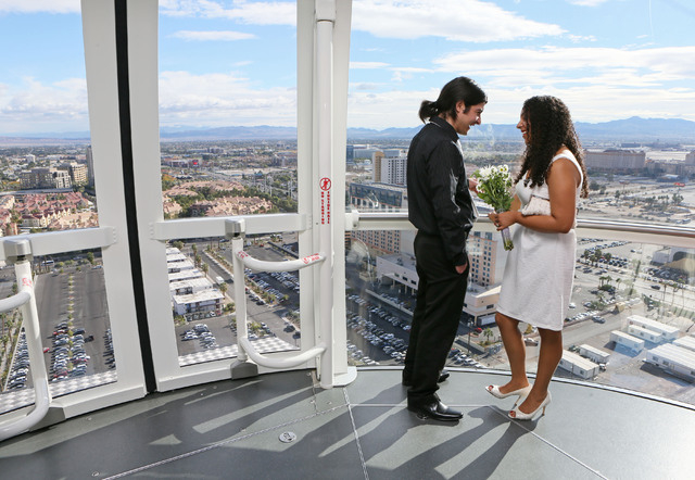 Michael Hurtado and his wife Daisy share a moment after participating in a vow renewal ceremony on The High Roller Saturday, Dec. 13, 2014, in Las Vegas. The High Roller offered free in-cabin wedd ...