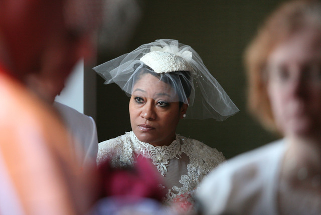 Bride Tanya Richards looks around in a crowded room prior to the start of in-cabin wedding ceremonies at The High Roller Saturday, Dec. 13, 2014, in Las Vegas. The High Roller offered free wedding ...