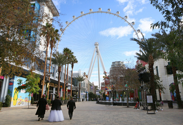 A bride walks towards The High Roller Saturday, Dec. 13, 2014, in Las Vegas. The High Roller offered free in-cabin wedding and vow renewal ceremonies for two hours and two minutes on 12/13/14, whi ...