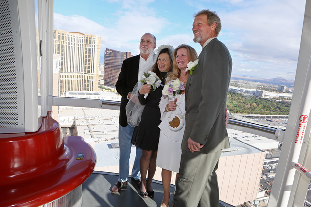 Bill Toffelmire, from left, Kim Toffelmire, Daphne Hoffman and Lyle Hoffman stand for a personal photograph after participating in a vow renewal ceremony on The High Roller Saturday, Dec. 13, 2014 ...