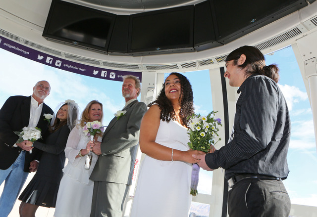 Couples, from left, Bill and Kim Toffelmire; Daphne and Lyle Hoffman; and Daisy and Michael Hurtado participate in a vow renewal ceremony on The High Roller Saturday, Dec. 13, 2014, in Las Vegas.  ...