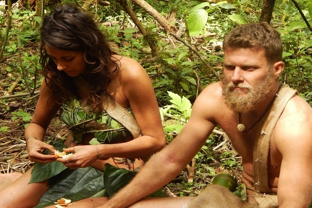 """In this photo provided by the Discovery Channel, Jaclyn, left, and Adam eat mandarins while sitting down in a scene from the TV series, """"Naked and Afraid."""" Nudity is reality TV's latest  ..."""