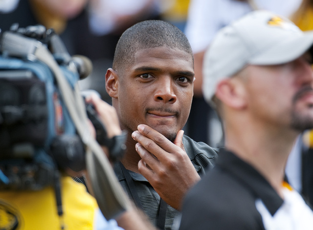 NFL rookie Michael Sam watches the Missouri-South Dakota State game on Saturday. Sam, the first openly gay player drafted by an NFL team, was released by St. Louis Rams and cleared waivers. The Da ...