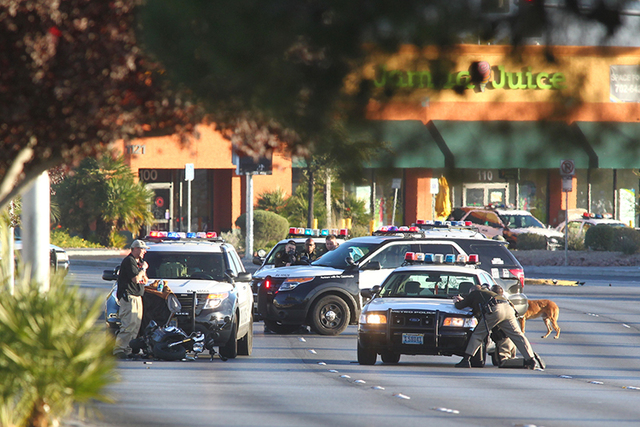 Traffic and businesses in the area of Decatur and Charleston boulevards are closed while police negotiate with a man threatening to shoot himself, according to Las Vegas police. (Chase Stevens/Las ...