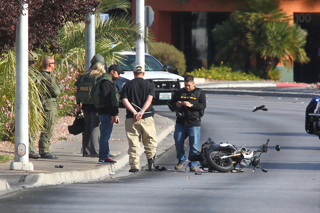 Las Vegas police detain a suicidal man who was armed after a standoff on Decatur Boulevard near Charleston Boulevard in Las Vegas on Monday, Dec. 1, 2014. Chase Stevens/Las Vegas Review-Journal) ( ...