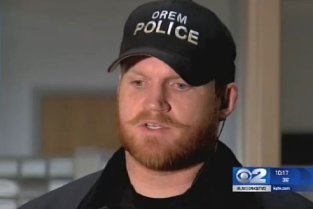 Orem, Utah, Police Officer Greer Haymond and fellow officers collected money to buy a Christmas tree and ornaments for a couple who lost their home to a fire on Nov. 24. (Courtesy/Screengrab, KUTV)