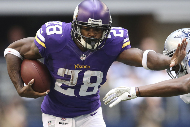 Minnesota Vikings Adrian Peterson runs with ball against the Dallas Cowboys in the first quarter at AT&T Stadium in Arlington, Texas in this file photo taken November 3, 2013. (REUTERS/Matthew Emm ...
