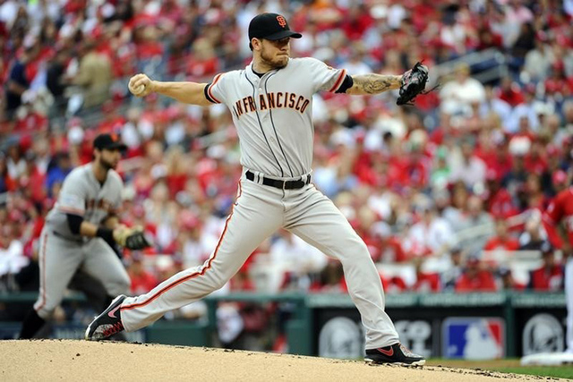 Oct 3, 2014; Washington, DC, USA; San Francisco Giants starting pitcher Jake Peavy (22) pitches against the Washington Nationals in the first inning of game one of the 2014 NLDS playoff baseball g ...