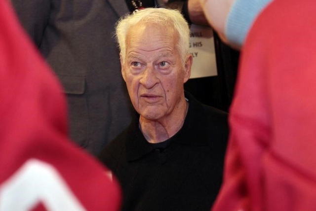 Former Detroit Red Wings player Gordie Howe signs autographs for fans in celebration of his 85th birthday before the start of the Red Wing's NHL hockey game against the Chicago Blackhawks in Detro ...