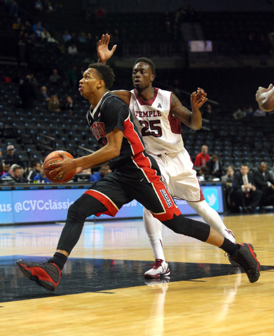 UNLV Runnin' Rebels guard Rashad Vaughn (1) dribbles the ball past Temple Owls guard Quenton DeCosey (25) during the first half at Barclays Center on Nov. 14, 2014, in Brooklyn, N.Y. (Brad Penner- ...