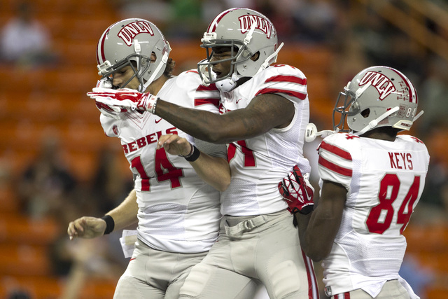UNLV quarterback Jared Lebowitz (14) celebrates with wide receivers Devante Davis (81) and Kendal Keys (84) after Lebowitz's first quarter touchdown run against Hawaii at Aloha Stadium in Honolulu ...