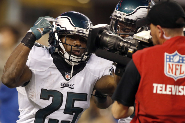 Nov 27, 2014; Arlington, TX, USA; Philadelphia Eagles running back LeSean McCoy (25) celebrates a touchdown in the third quarter against the Dallas Cowboys. Mandatory Credit: Tim Heitman-USA TODAY ...
