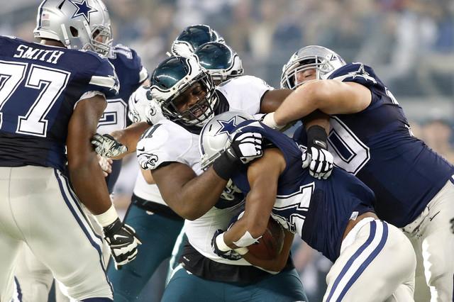 Philadelphia Eagles defensive end Fletcher Cox (91) tackles Dallas Cowboys running back Joseph Randle (21) on Thanksgiving. Philadelphia beat Dallas 33-10. (Tim Heitman-USA TODAY Sports)