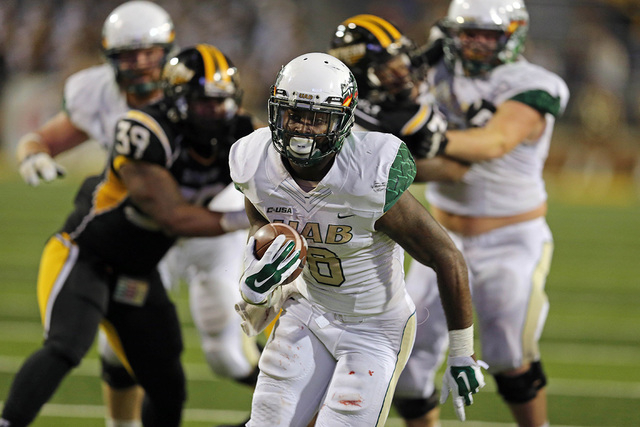 Nov 29, 2014; Hattiesburg, MS, USA; UAB Blazers running back D.J. Vinson (6) carries the ball to score a touchdown in the second half against the Southern Miss Golden Eagles at M.M. Roberts Stadiu ...