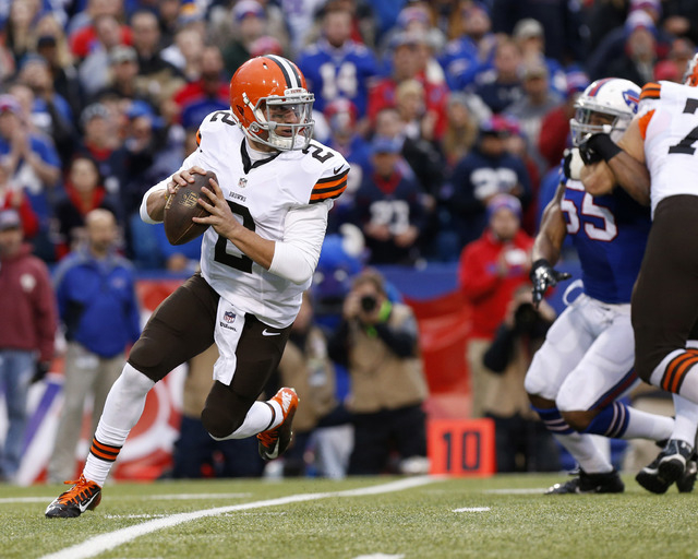 Nov 30, 2014; Orchard Park, NY, USA; Cleveland Browns quarterback Johnny Manziel (2) runs with the ball against the Cleveland Browns during the second half at Ralph Wilson Stadium. Bills beat the  ...
