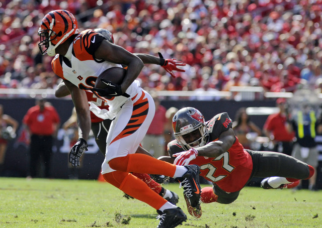 Nov 30, 2014; Tampa, FL, USA; Cincinnati Bengals wide receiver A.J. Green (18) turns upfield while Tampa Bay Buccaneers cornerback Johnthan Banks (27) attempts to tackle as the Bengals beat the Bu ...