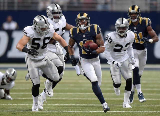 Nov 30, 2014; St. Louis, MO, USA; (Editors note: Caption correction) St. Louis Rams receiver Stedman Bailey (12) is pursued by Oakland Raiders players Miles Burris (56), Khalil Mack (52) and Tarel ...