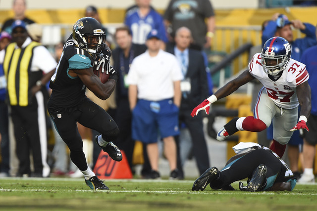 Nov 30, 2014; Jacksonville, FL, USA; Jacksonville Jaguars wide receiver Marqise Lee (11) runs with the ball during the fourth quarter against the New York Giants at EverBank Field. The Jaguars won ...