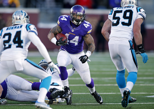 Nov 30, 2014; Minneapolis, MN, USA; Minnesota Vikings running back Matt Asiata (44) rushes against the Carolina Panthers for 3 yards in the fourth quarter at TCF Bank Stadium. The Vikings won 31-1 ...