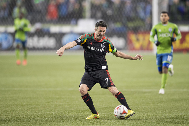 Nov 30, 2014; Seattle, WA, USA; Los Angeles Galaxy forward Robbie Keane (7) passes the ball against the Seattle Sounders FC in the second half during the Western Conference Championship at Century ...