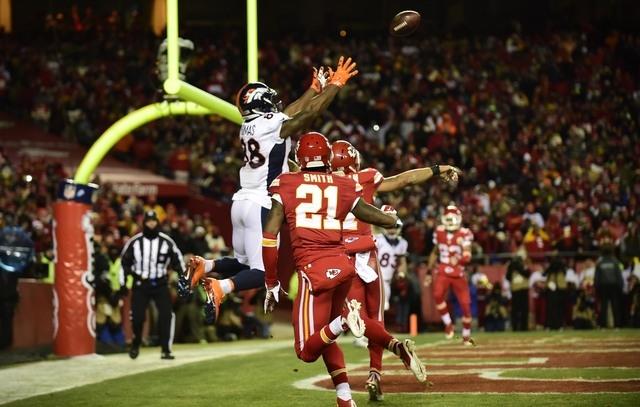 Nov 30, 2014; Kansas City, MO, USA; Denver Broncos wide receiver Demaryius Thomas (88) attempts a reception over Kansas City Chiefs cornerback Sean Smith (21) in the second quarter at Arrowhead St ...