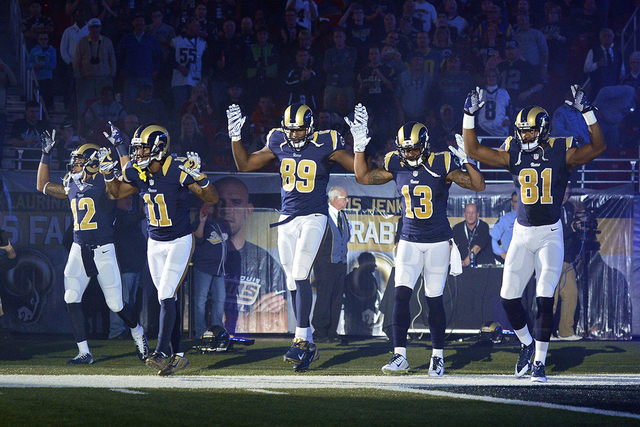 St. Louis Rams wide receiver Stedman Bailey (12), wide receiver Tavon Austin (11), tight end Jared Cook (89), wide receiver Chris Givens (13) and wide receiver Kenny Britt (81) put their hands up  ...