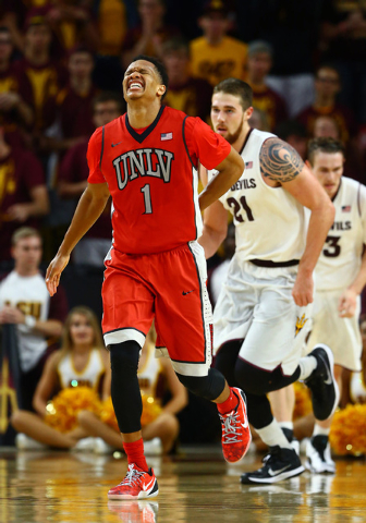 UNLV Runnin' Rebels guard Rashad Vaughn (1) reacts after suffering an injury in the second half against the Arizona State Sun Devils at Wells-Fargo Arena. Vaughn would leave the game. Sun Devils d ...