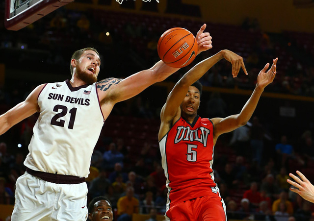 Arizona State Sun Devils forward Eric Jacobsen (21) grabs a rebound against UNLV Runnin' Rebels forward Christian Wood (5) in the second half at Wells-Fargo Arena. The Sun Devils defeated the Runn ...