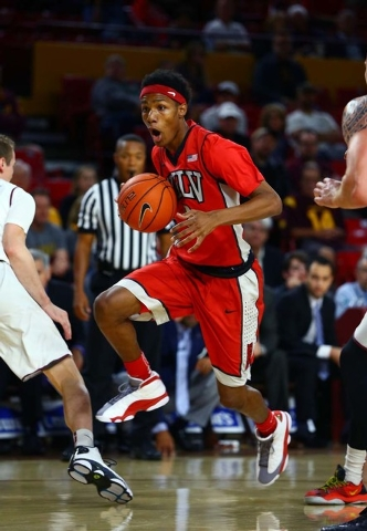 UNLV Runnin' Rebels guard Patrick McCaw (2) drives to the basket in the first half against the Arizona State Sun Devils at Wells-Fargo Arena. Sun Devils defeated the Runnin' Rebels 77-55. (Mark J. ...