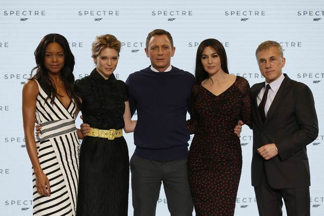 "Actors Naomie Harris, Lea Seydoux, Daniel Craig, Monica Bellucci and Christoph Waltz pose on stage during an event to mark the start of production for the new James Bond film ""SPECTRE"" at Pinewood ..."