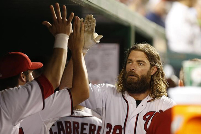 Aug 22, 2014; Washington, DC, USA; Washington Nationals right fielder Jayson Werth (28) celebrates with teammates in the dugout after hitting a home run against the San Francisco Giants in the fou ...