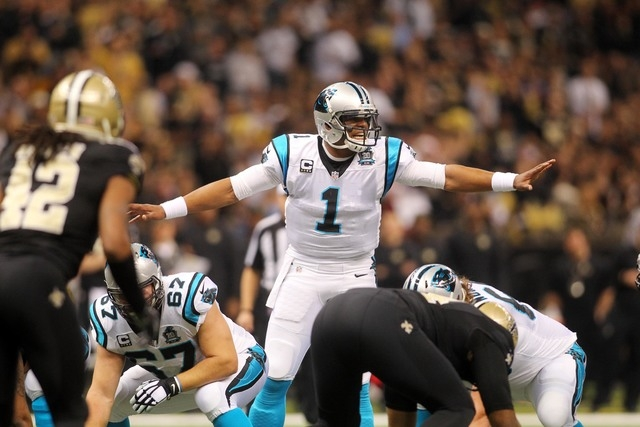 Dec 7, 2014; New Orleans, LA, USA; Carolina Panthers quarterback Cam Newton (1) motions prior to the snap in the first quarter against the New Orleans Saints at the Mercedes-Benz Superdome. (Cryst ...