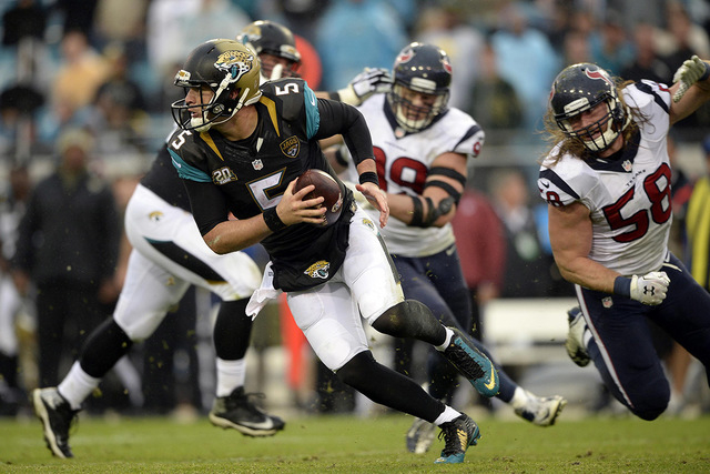 Dec 7, 2014; Jacksonville, FL, USA; Jacksonville Jaguars quarterback Blake Bortles (5) scrambles out of the pocket against the Houston Texans at EverBank Field. (Richard Dole-USA TODAY Sports)