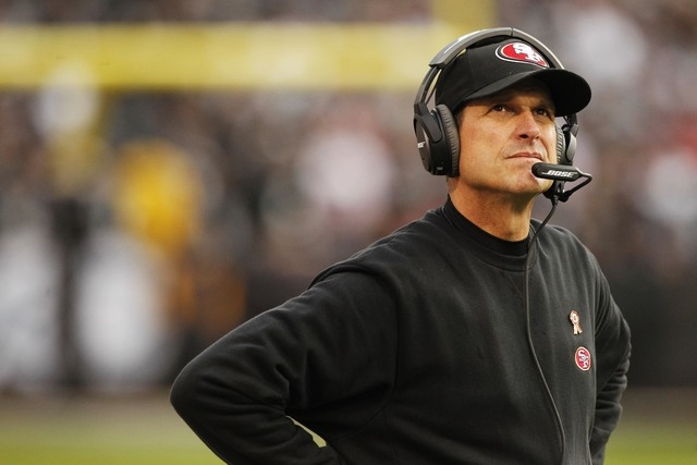Jim Harbaugh signed a contract with his alma mater on Monday night, the Detroit News reported. (Cary Edmondson-USA TODAY Sports)