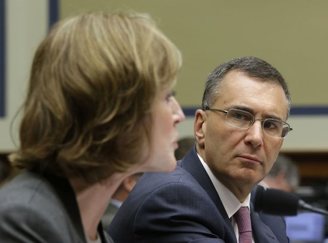 Obamacare consultant Jonathan Gruber, right, listens to Centers for Medicare and Medicaid Services Administrator Marilyn Tavenner during testimony before a U.S. House Oversight and Government Refo ...