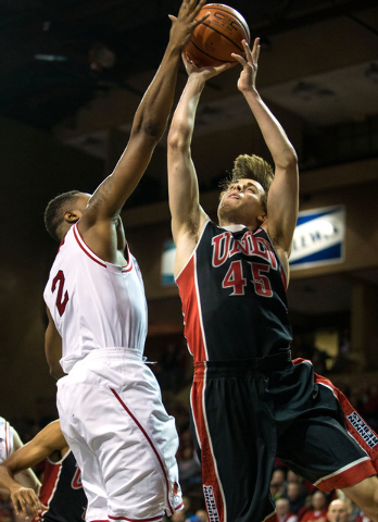UNLV Rebels guard Cody Doolin (45) is blocked by South Dakota Coyotes guard Tre Burnette (2) during the first half at Sanford Pentagon in Sioux Falls, S.D., on Saturday, Dec. 13, 2014. (Brace Hemm ...