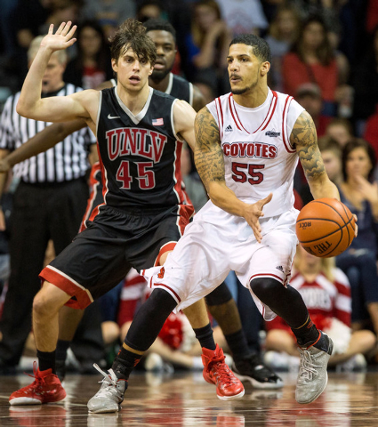 South Dakota Coyotes guard Tyler Larson (55) dribbles against UNLV Rebels guard Cody Doolin (45) during the first half at Sanford Pentagon in Sioux Falls, S.D., on Saturday, Dec. 13, 2014. (Brace  ...