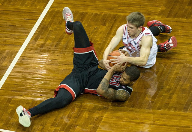 South Dakota Coyotes guard Casey Kasperbauer (14) ties up UNLV Rebels guard Jelan Kendrick (22) for a jump ball during the second half at Sanford Pentagon. UNLV defeated South Dakota  75-61 in Sio ...