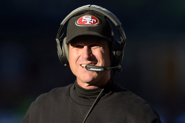 Dec 14, 2014; Seattle, WA, USA; San Francisco 49ers coach Jim Harbaugh reacts in the first quarter against the Seattle Seahawks at CenturyLink Field. (Kirby Lee-USA TODAY Sports)
